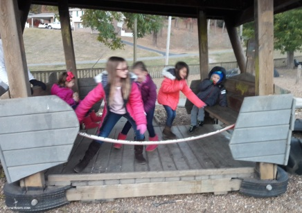The kids on the swinging bench