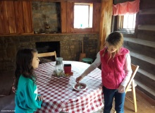 Caitlyn and Emily inside the cabin