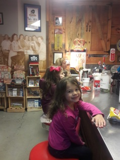 Lila at the Moon Pie General Store counter