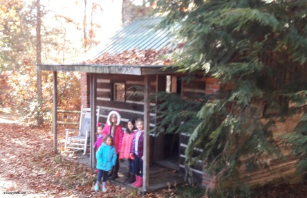 The girl cousins in front of the cabin