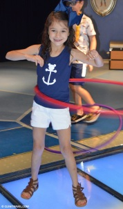 Caitlyn hula-hooping in the main area