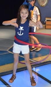 Caitlyn hula-hooping in the main area