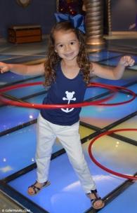 Lila hula-hooping in the main area